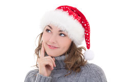 Beautiful woman in winter clothes and santa hat dreaming isolate Stock Images