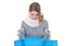 Beautiful woman in winter clothes with shopping bags isolated on Stock Photography