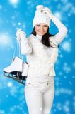 Beautiful woman in winter clothes with skates. Beautiful woman in winter white clothes with skates Stock Photos