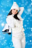 Beautiful woman in winter clothes with skates. Stock Photography