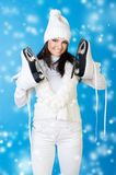 Beautiful woman in winter clothes with skates. Royalty Free Stock Image