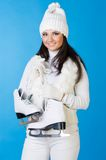 Beautiful woman in winter clothes with skates. Beautiful woman in winter white clothes with skates Royalty Free Stock Photography