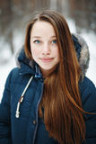 Beautiful woman in winter clothes standing in winter par Stock Photo