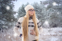 Beautiful woman in winter clothes walking in forest Royalty Free Stock Images
