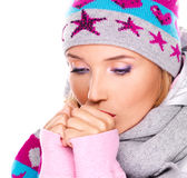 Beautiful woman in winter clothes warming her hands Stock Photo