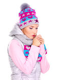 Beautiful woman in winter clothes warming her hands Royalty Free Stock Photo