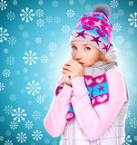 Beautiful woman in winter clothes warming her hands Royalty Free Stock Images