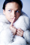 Beautiful woman in winter clothing. Portrait of a beautiful young girl in winter clothing Royalty Free Stock Images