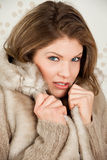 Beautiful woman in winter coat feels cold Royalty Free Stock Image