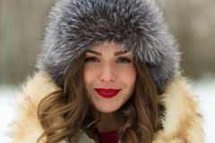 Beautiful woman in winter coat and fur hat Royalty Free Stock Photos