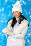 Beautiful woman in winter fashion with snowball. Stock Photography