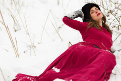 Beautiful woman in winter field Stock Images