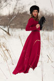 Beautiful woman in winter field Royalty Free Stock Photography