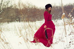 Beautiful woman in winter field Stock Photos