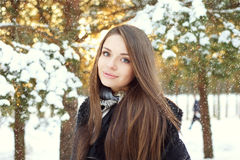 Beautiful woman in winter forest. Winter portrait of beautiful young woman with snowflakes in forest Royalty Free Stock Photo