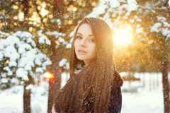 Beautiful woman in winter forest. Winter portrait of beautiful young woman with snowflakes in forest Royalty Free Stock Photos