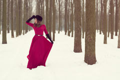 Beautiful woman in winter forest Royalty Free Stock Photo