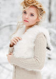 Beautiful woman in winter forest Royalty Free Stock Photography