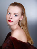 Beautiful woman in winter fur coat. Royalty Free Stock Images