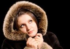 Beautiful woman in winter fur coat Stock Photos