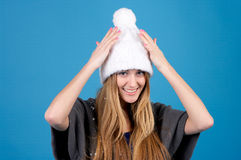 Beautiful woman in winter hat Stock Photography