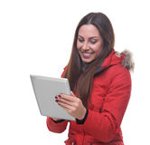 Beautiful woman in winter jacket using tablet pc Royalty Free Stock Images