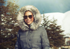 Beautiful woman in the winter mountains Royalty Free Stock Photography