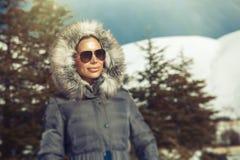 Beautiful woman in winter mountains Stock Photo