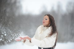 Beautiful woman in winter park Stock Photos