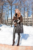 Beautiful woman  in a winter park Royalty Free Stock Photo