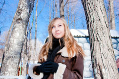 Beautiful woman  in a winter park Stock Photos