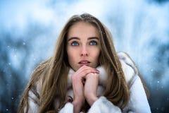 Beautiful woman at the winter park Stock Photos