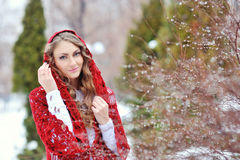 Beautiful woman in winter in a park in red kerchief Royalty Free Stock Photography