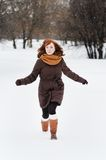 Beautiful woman in winter park. Young beautiful woman walking in winter park Royalty Free Stock Photos
