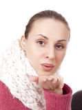Beautiful woman in winter scarf blow kisses Royalty Free Stock Images