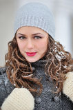Beautiful woman in winter with snow on the hair Royalty Free Stock Photos