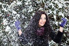Beautiful woman in winter snowy forest Royalty Free Stock Photography