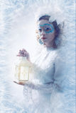 Beautiful woman with winter style makeup and lantern royalty free stock image