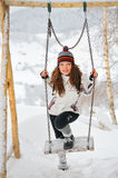 Beautiful Woman in winter time and swing Royalty Free Stock Photography