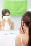 Beautiful woman wipes her face Royalty Free Stock Photography