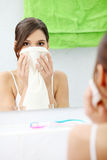 Beautiful woman wipes her face Stock Photo