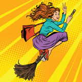 Beautiful woman witch flying on a broom Royalty Free Stock Photo