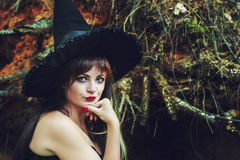 Beautiful woman in a witch hat Royalty Free Stock Image