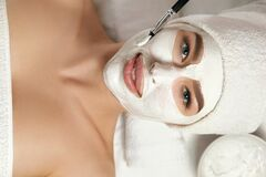 Free Beautiful Woman With A Clay Mask On Her Face. Facial Peeling Mask. Spa Skin And Body Care. Female Facial Of Beauty Treatment. Stock Image - 213923681