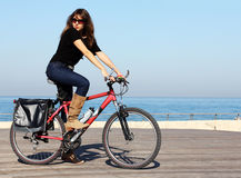 Beautiful Woman With Bicycle Royalty Free Stock Photos