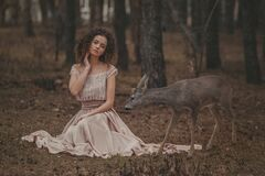 Beautiful Woman With Deer Photoshoot Royalty Free Stock Image