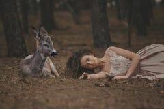 Beautiful Woman With Deer Photoshoot Stock Photo