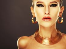Beautiful Woman With Evening Make-up And Gold Jewelry. Stock Photo