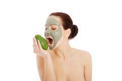 Beautiful Woman With Facial Mask Holding Avocado. Royalty Free Stock Photos