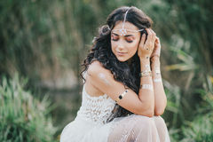 Free Beautiful Woman With Long Curly Hair Dressed In Boho Style Dress Posing Near Lake Royalty Free Stock Images - 58696179